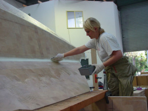 Jo Squeegeeing excess resin